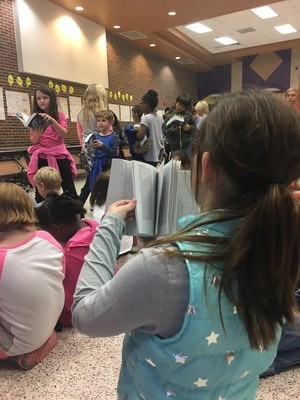 CCI third grade students get new dictionaries and enjoy using them right away