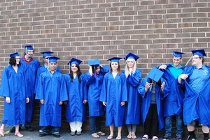 Group picture of students in cap and gown