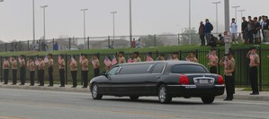 A limo with the Zerebny family driving past cadets holding American Flags