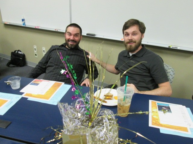 Two teachers participate in our new teacher end of the year celebration.