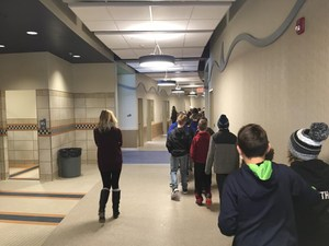 Students pass the new bathrooms and pass under the Midway