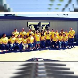 vista staff wearing yellow shirts