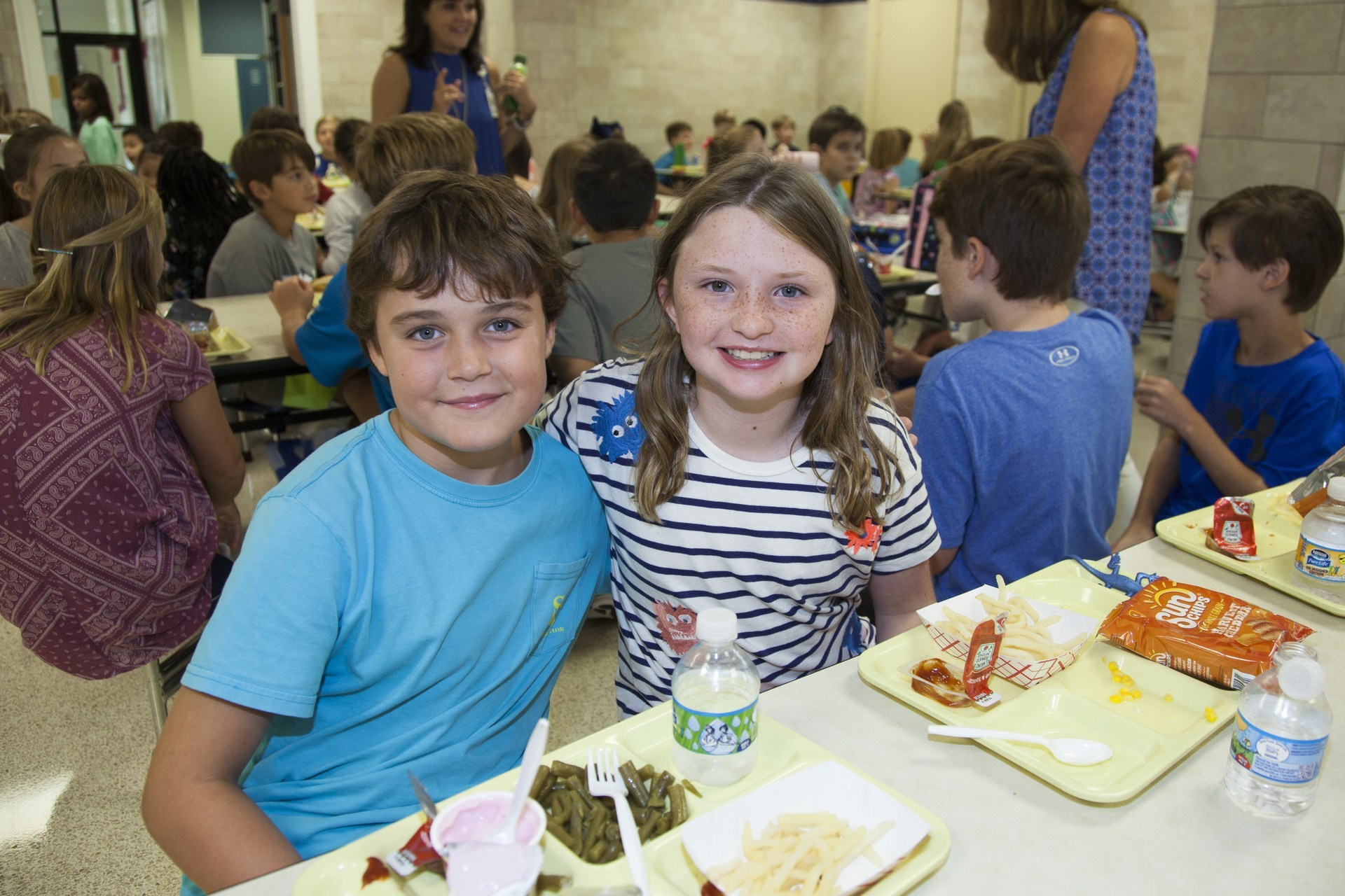 Two elementary school students enjoy their lunch at the Bradfield cafeteria