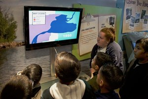 students, observing an interactive map