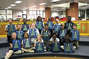 Ms. North's class painted their own illustration of a Christmas tree.