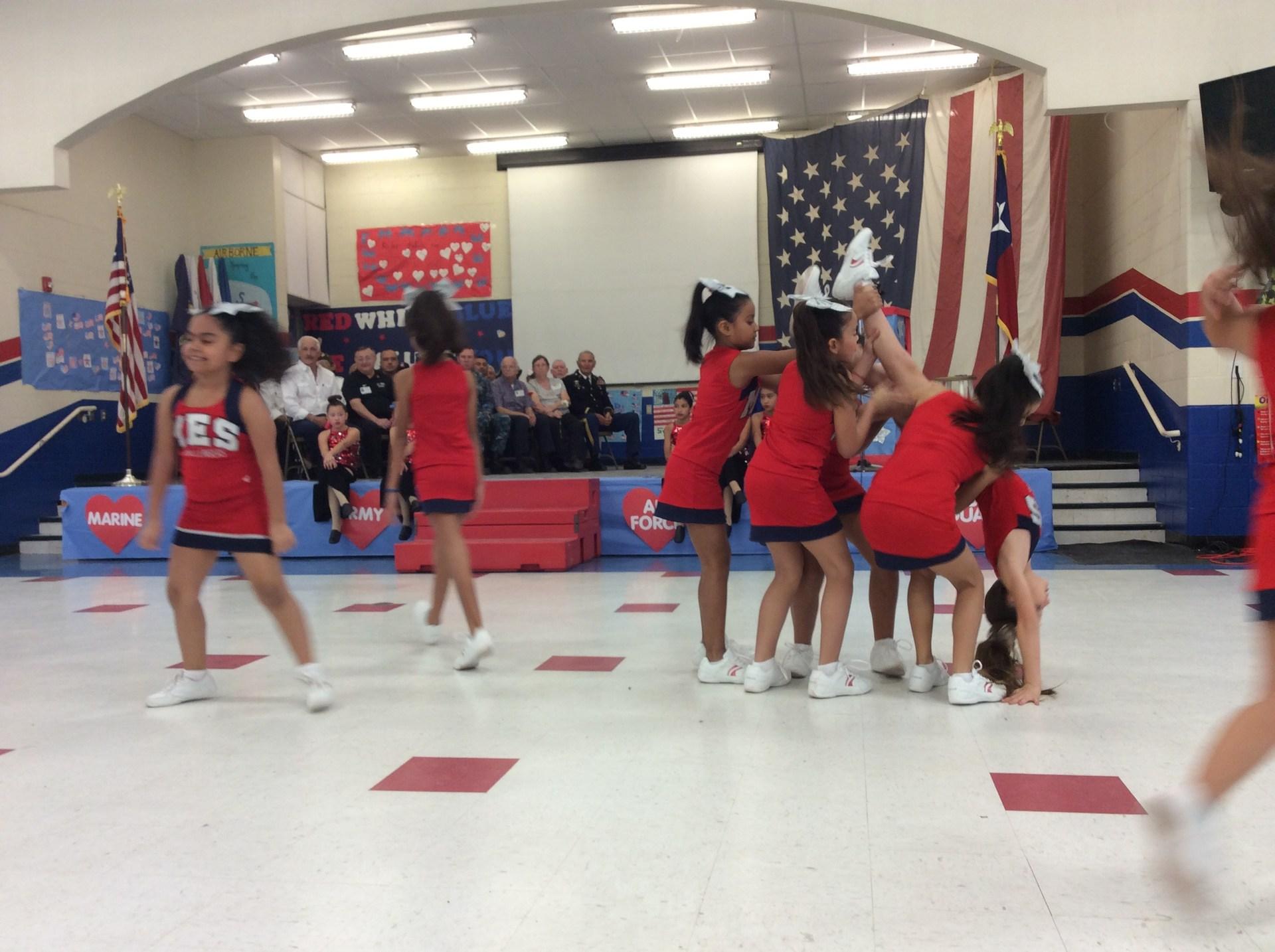 cheerleaders performing in gym.