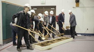 Groundbreaking ceremony takes palce in the gym.