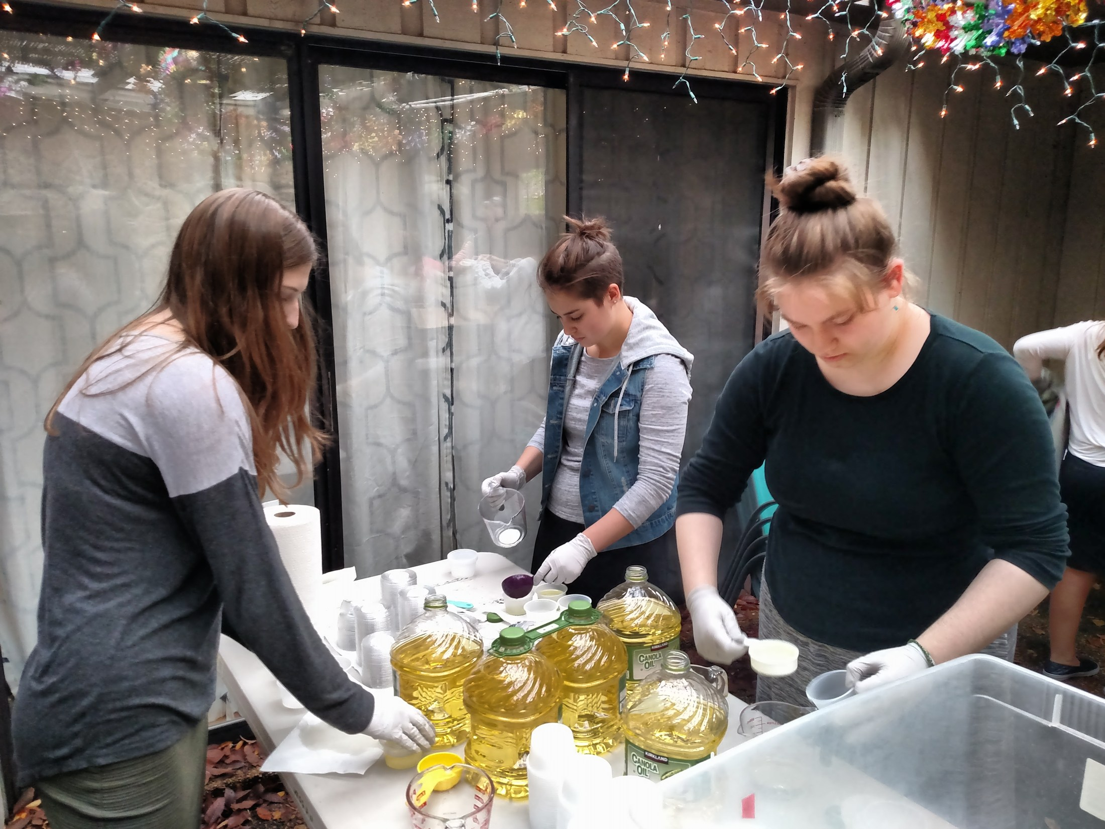 Girls high school students ready oil for holiday parties.