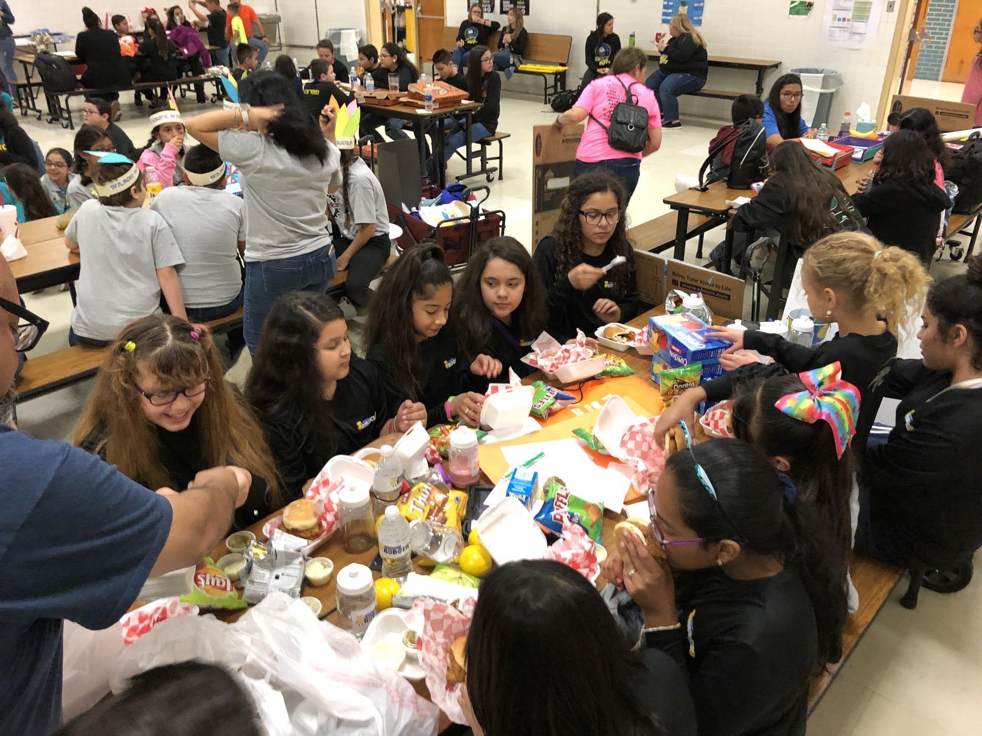 Robotics team eating