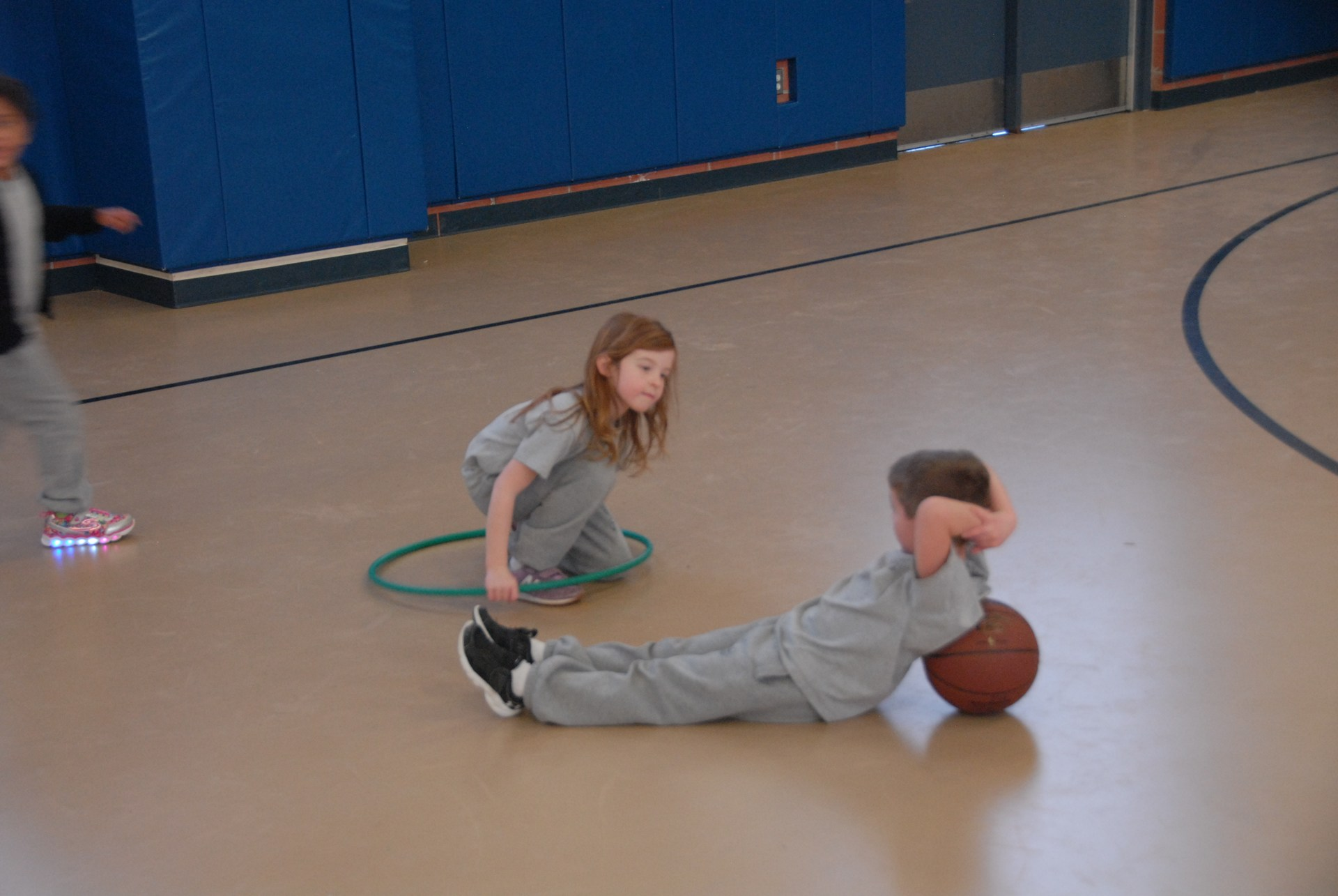 Two students talk during gym class