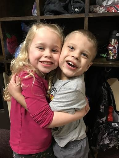 two students hugging