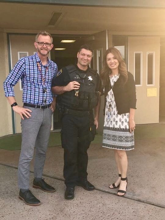 Assistant Principal (James Malone), Officer Ronny Ziya, and Principal (Jeannette Alday) welcome families at Back to School Night