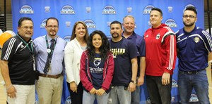 Soleya Figeroa surrounded by father, coaches, and school staff.