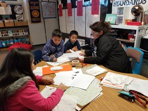 BPUSD_KENMORE_2: Kenmore Elementary School teacher Margarita Berdeja works with an intervention group of students who are approaching proficiency in math.