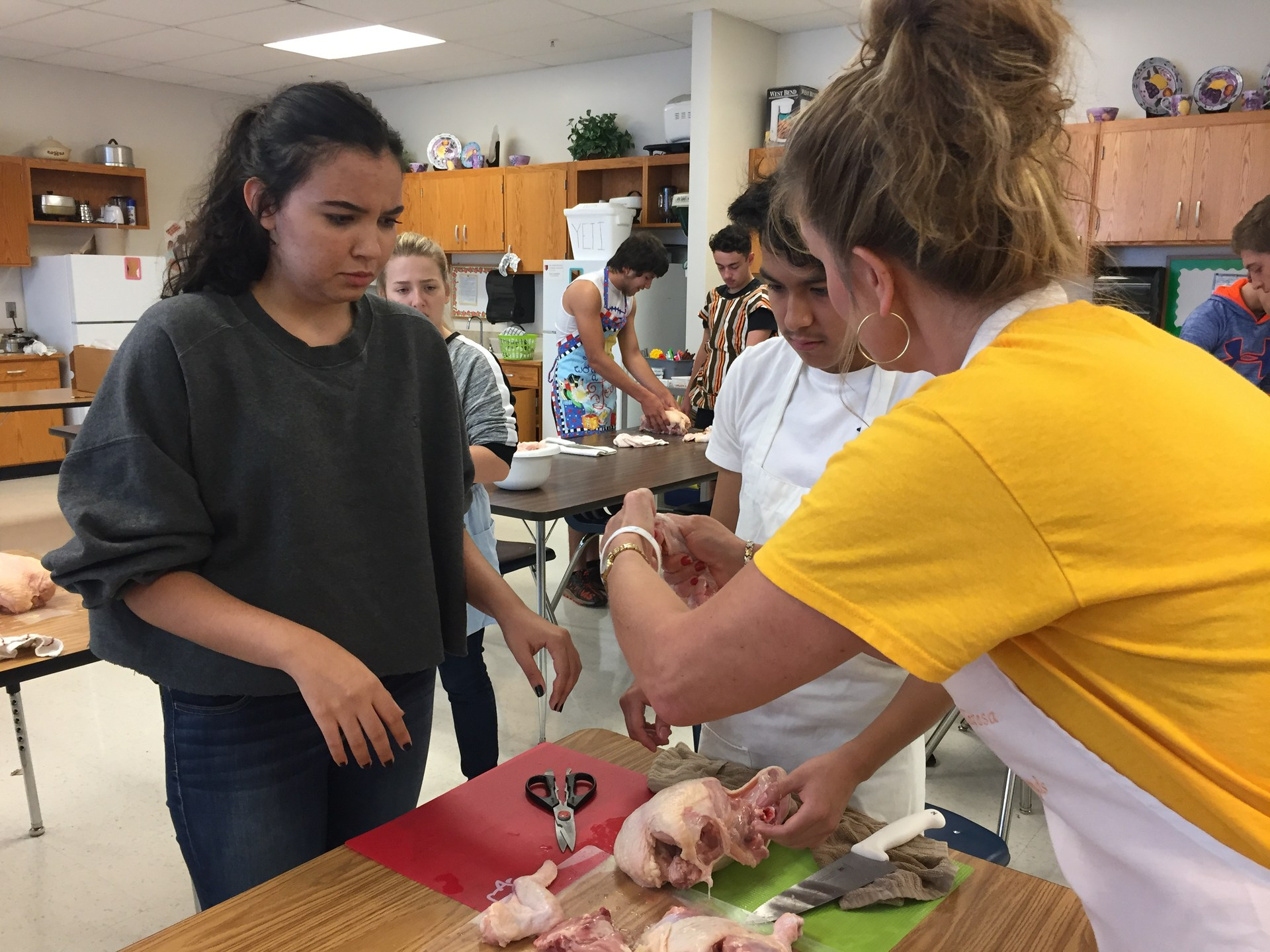 Students participating in Chicken Prep Lab at North Wilkes High