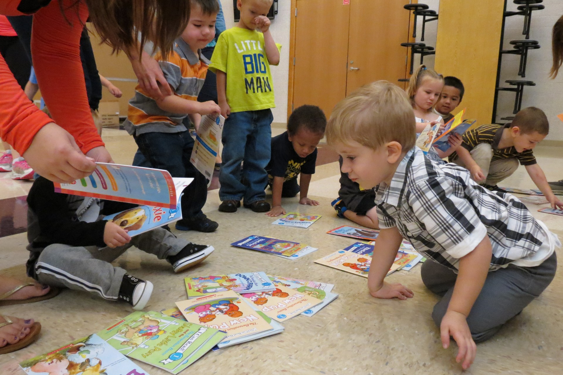 Children pick out a book that they receive free at each Tots 'n Tunes