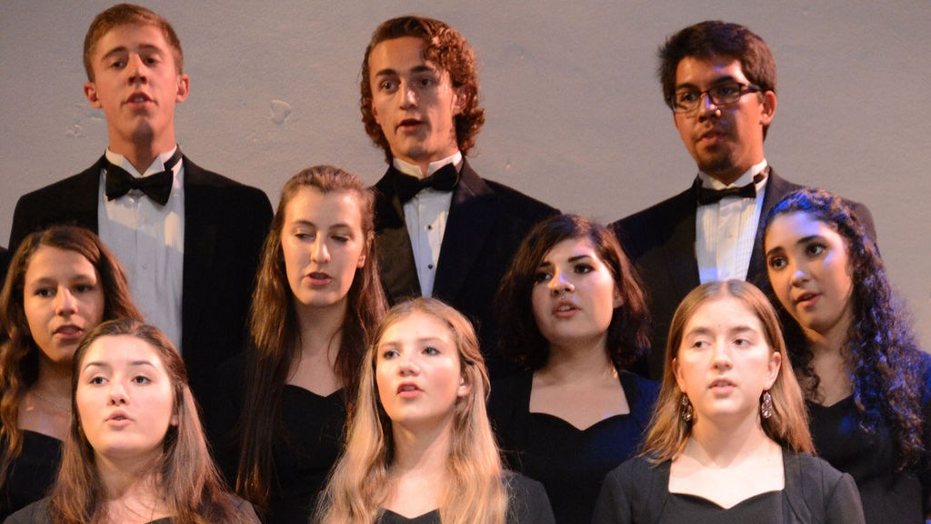 Upper school students sing
