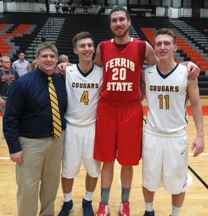 TKHS alumni return home for college exhibition basketball game.