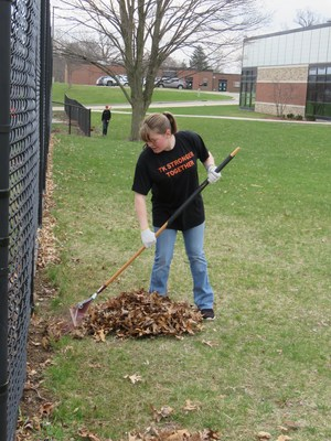 Leaves along the basketball court at McFall were raked up by students.