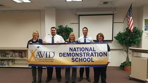 From left to right: Kelly Sullivan (elective teacher), me, Carol Lewis ( coordinator), Jason Luna ( Assistant Principal), Terry Whitton (Co Coordinator) holding an AVID sign.