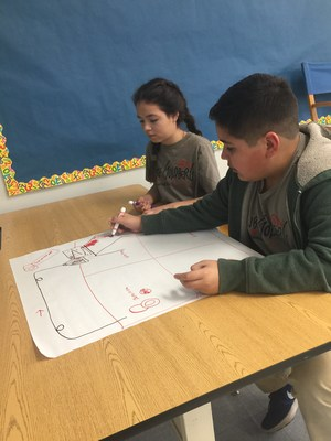 BPUSD_RUBE_2: Walnut Elementary School fifth-graders Paola Tamayo and David Trejo brainstorm ideas for a Rube Goldberg device as part of the Baldwin Park Unified 21st Century Challenge.