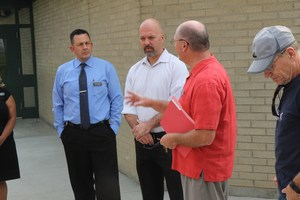 WSSDA Executive Director Tim Garchow speaks with District leaders at Adams Elementary