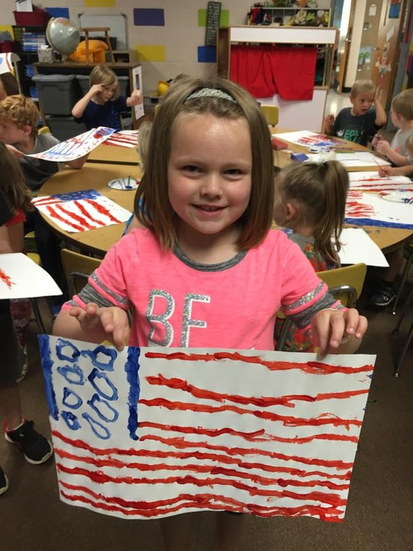 Students paint their own American Flags in Mr. Williams' Kindergarten Class. Featured Photo