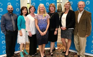 Left to right: Executive Director of Human Resources Dr. Dylan Farris, Board Member Jeanie Nishime, Center Street Principal Martha Monahan, Teacher of the Year Renee Hoover, Superintendent Dr. Melissa Moore, Executive Director of Education Services Marisa Janicek, Board President Dr. Bill Watkins.
