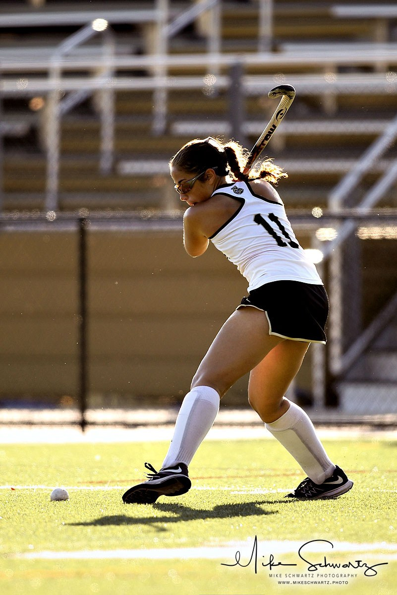 CHS girls field hockey player strikes the ball