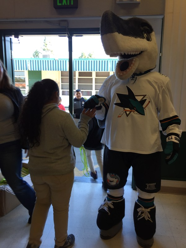 SJ Sharks Mascot high fives student during Stick to Fitness assembly