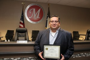 MISD Board Member Johnny Velasco with his award from the Travis County Justice Planning Workforce Development Task Force.