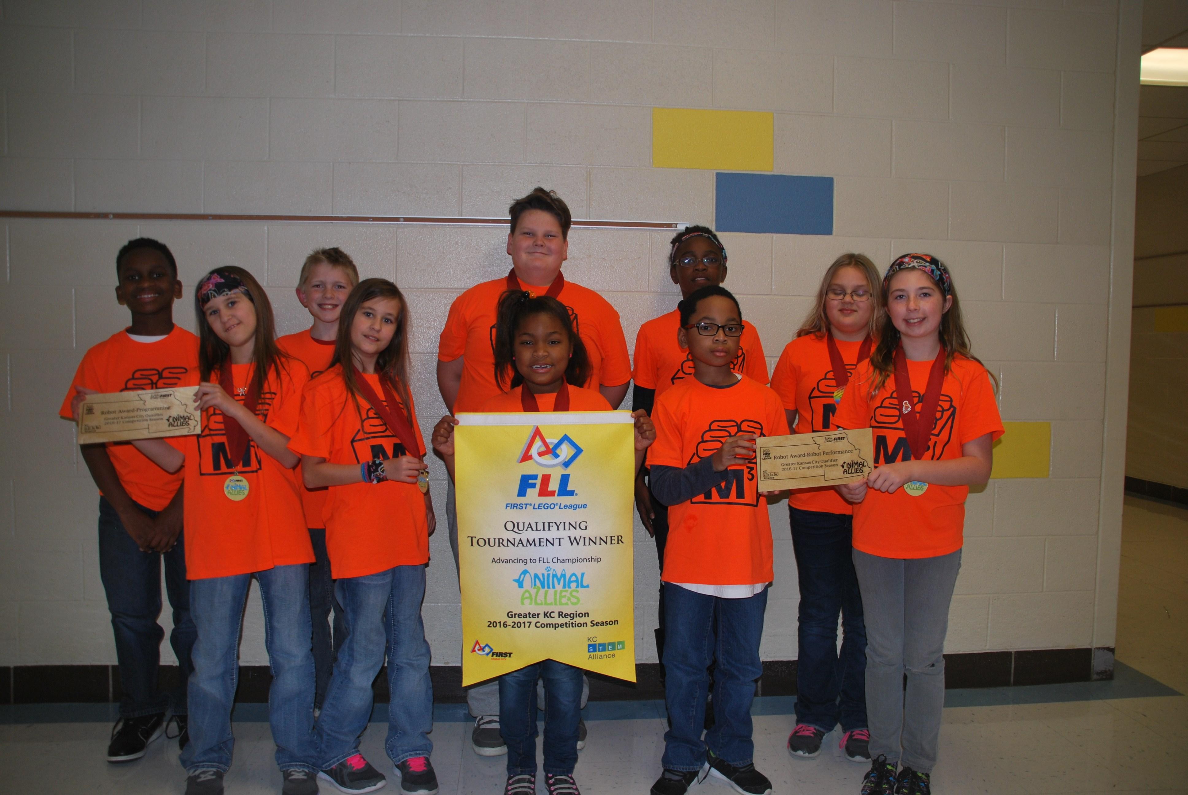 Meadowmere robotics team holding award.