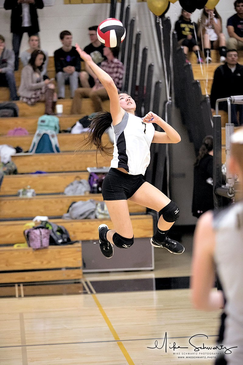 CHS girls volleyball player spikes the ball