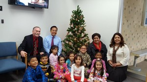 After decorating a Christmas tree in the lobby of the Baldwin Park Unified District Office on Dec. 16, students from Vineland Elementary School snap a picture with Superintendent Froilan N. Mendoza (second from left) and district leaders.