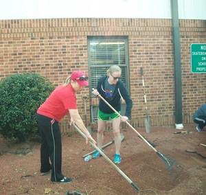 Volunteers work to improve Pilot School grounds.