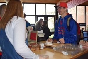 Teen buying muffin