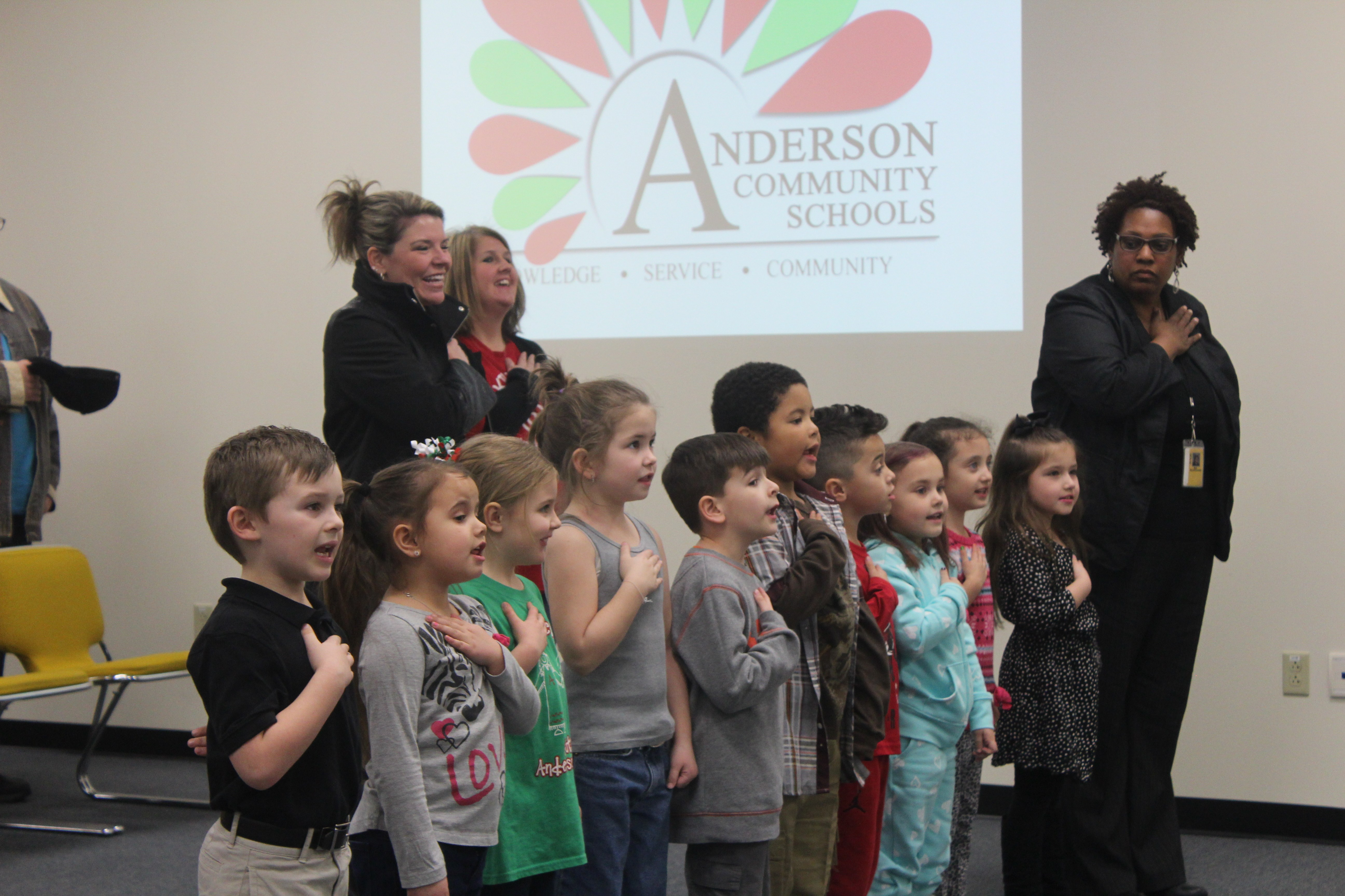 Kindergarten students leading the Pledge of Allegiance at a Board meeting