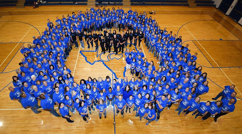 QISD Staff form the shape of a Q with QISD Police in the center of the Q to show support