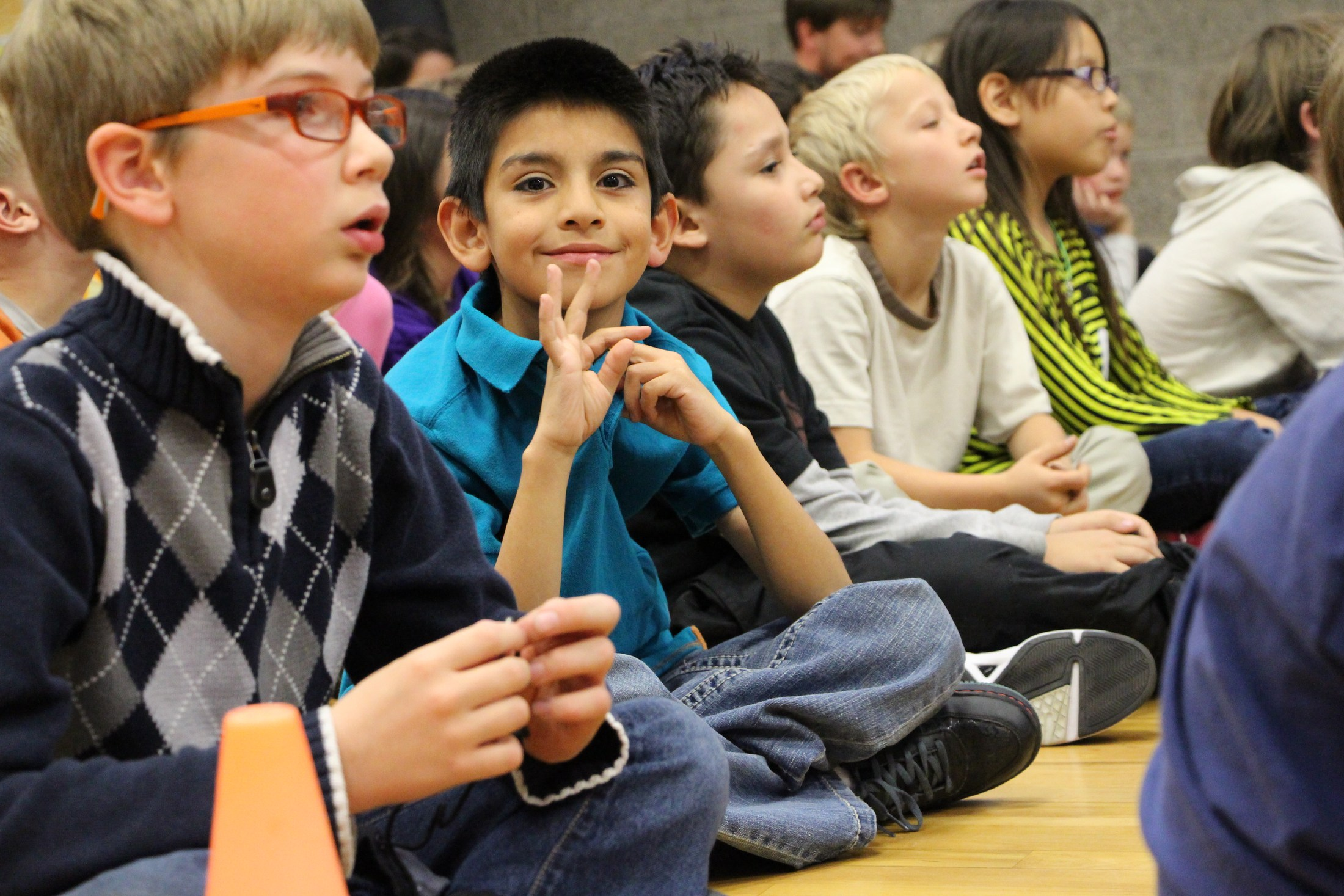 Students sit in a school assembly.