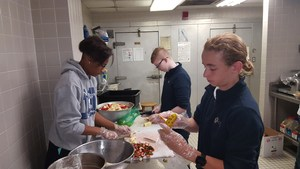 OLSH students prepare food at a local soup kitchen.