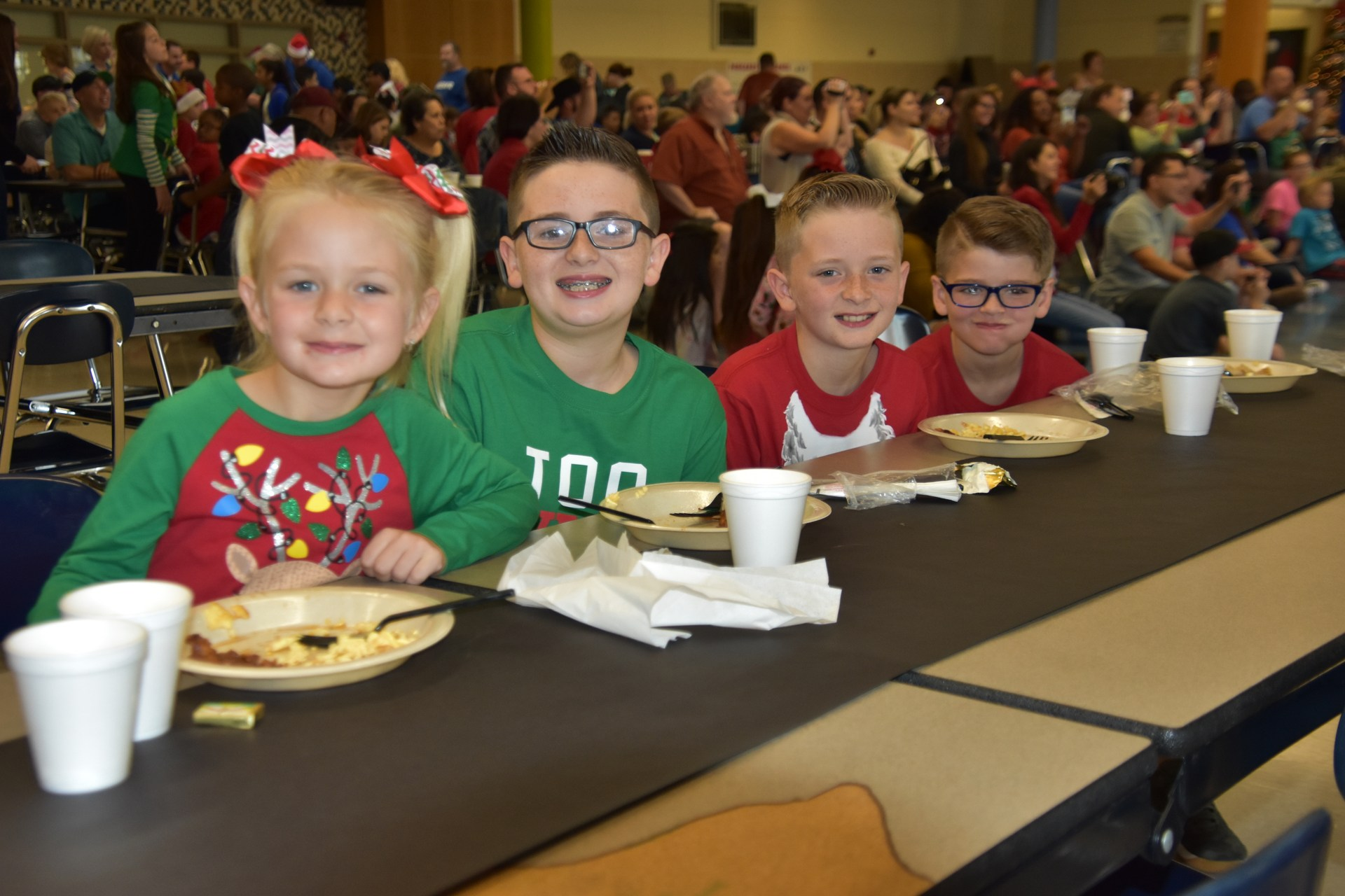 Kids enjoy a pancake breakfast during Pancakes with Santa.
