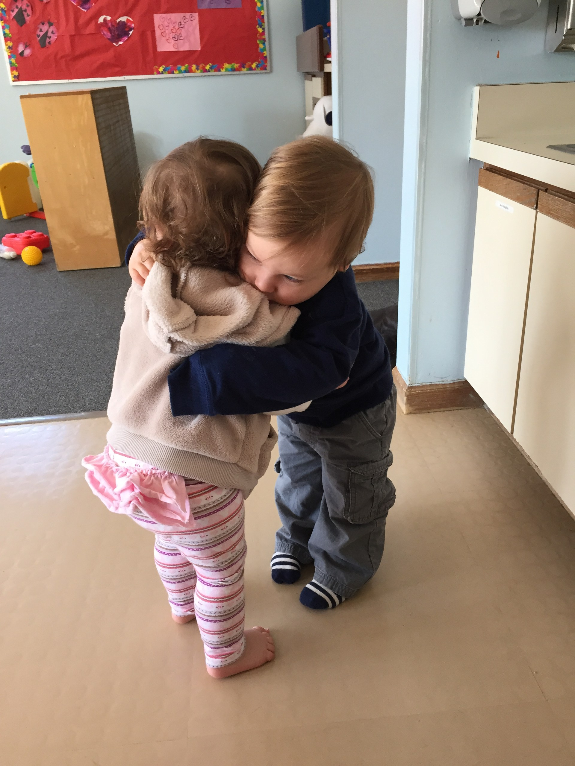 toddlers hugging