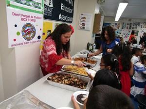 teacher serving food