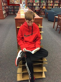 Student in Cardboard Chair