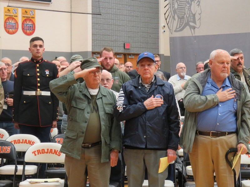 Veterans stand at attention as the flags are presented.