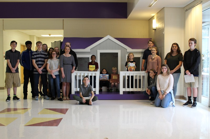 8th Grade Titans Present the Tiny House to WES Hornets