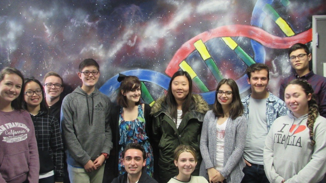 students in front of DNA double helix