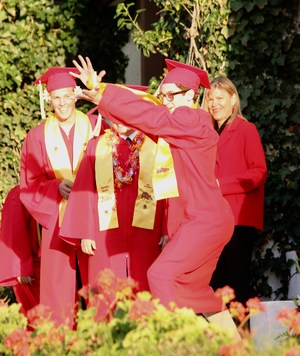 Hemet High School student dancing before getting his diploma