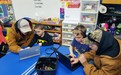 MCS Middle school students teach Kindergarten students how to code using code.org