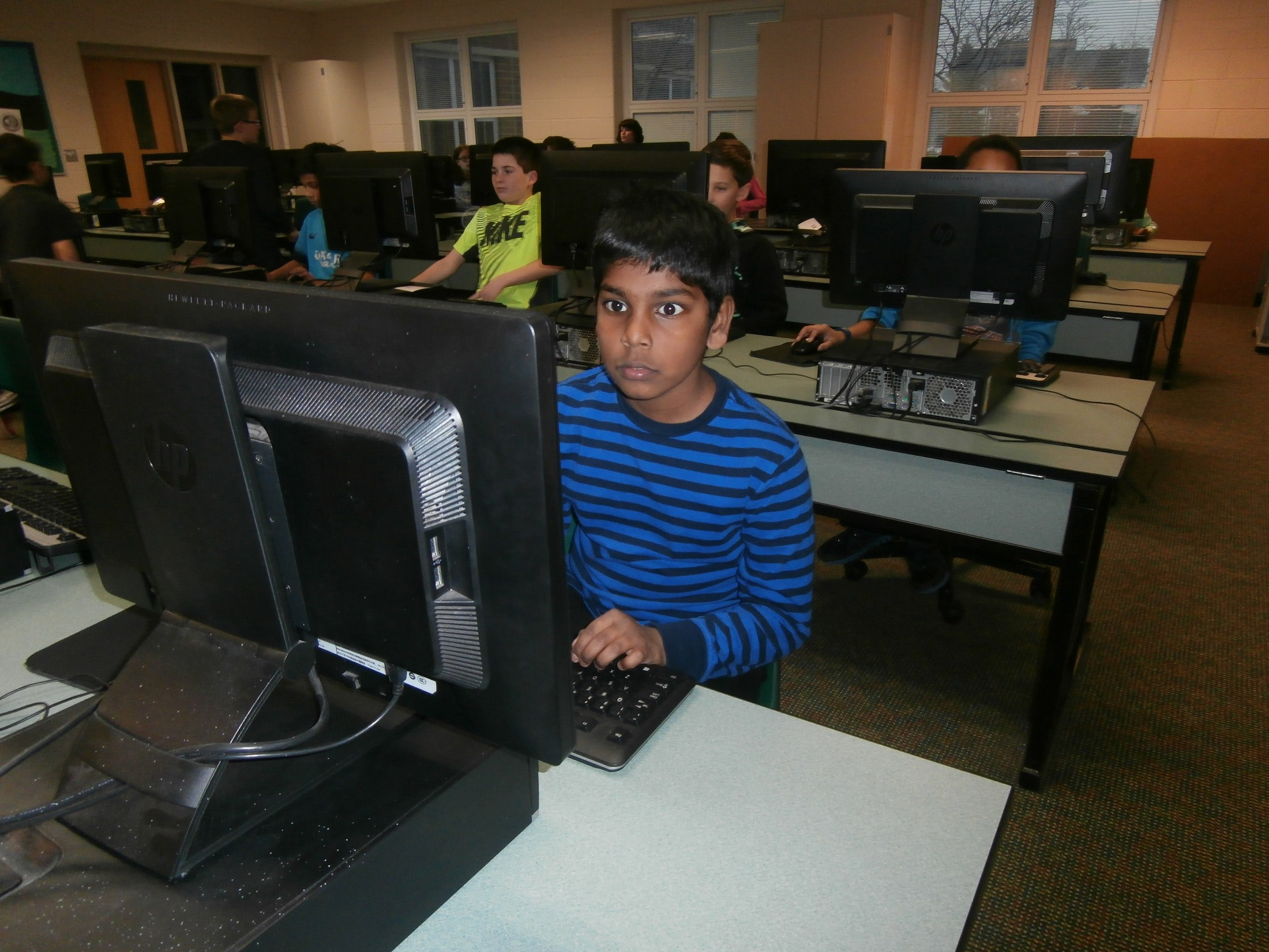 Computer lab time during Kids' Club.
